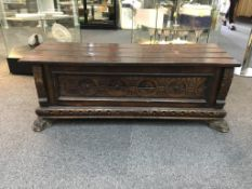Antique Coffer Carved rectangular coffer of small proportions with carved claw feet and slatted,