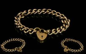 9ct Solid Gold - Unisex Curb Bracelet with Attached 9ct Gold Shield Shaped Padlock and Safety Chain