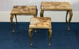 Nest Of Tables Three encapsulated onyx resin topped tables of rectangular form with ornate scroll