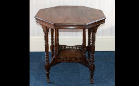 Octagonal Occasional Table On turned legs with castors and reticulated gallery stretcher.