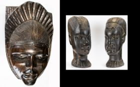 A Collection Of Carved African Objects Three items in total to include ebonised wood wall mask