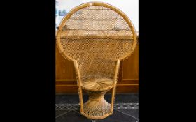 A 1970'S Wicker Peacock Chair Of Typical form, height 58 inches, dia, 42 inches.