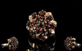 10ct Gold Garnet Set Cluster Dress Ring, Flower head Design. c.1960's / 1970's.