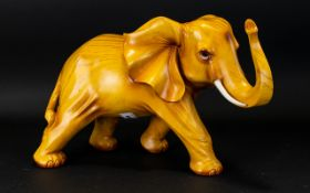 """A Carved Wooden Elephant standing position with raised trunk, attractive style, height 10""""."""
