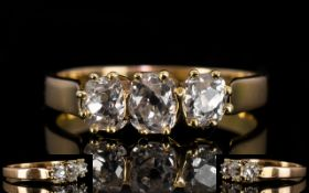 18ct Three Stone Diamond Ring Three old cut diamonds, claw set, continental assay marks,
