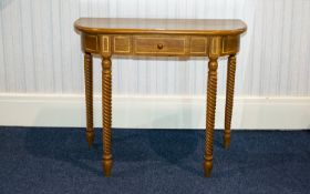 A Modern Yew Wood Console Table Comprising single frieze drawer above barley twist supports.