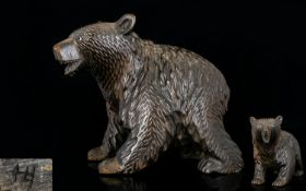 A Black Forest Carved Wood Bear with Bead Eyes. 7 Inches long x 6.5 Inches High.