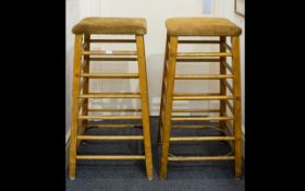 A Pair Of Suede Golden Oak And Beech 1950's Tall Gymnasium Stools Two square topped vaults of