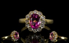 18ct Gold Diamond Dress Ring Set with central pink gemstone,