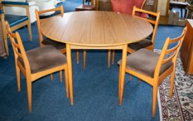 A 1970s Shreiber Dining Table and Four Chairs.