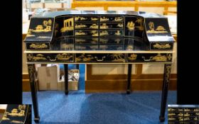 A Japanese Lacquered Bureau Raised on Square Tapering Legs comprising 13 drawers,