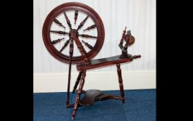 Spinning Wheel Floor standing wheel of traditional form with large wheel and turned spindle detail.