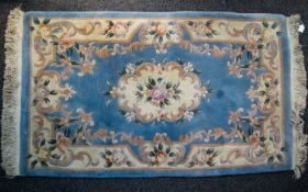A Large Woven Silk Carpet Keshan carpet on red ground with navy, ochre and cream repeated floral and