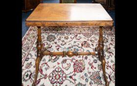 A Walnut Veneer Sofa Table.