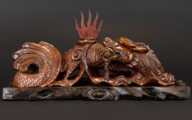 An Oriental Carved Figure In The Form Of A Dragon,