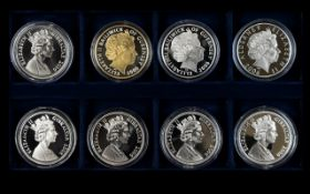A Boxed Collection of Elizabeth II Eight Silver Proof Five Pound Coins,