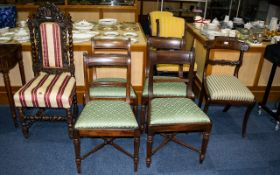 Four Victorian Dining Chairs Each with turned supports and cross stretcher,