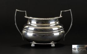 Early 20th Century Twin Handle Sugar Bowl Of Plain form with cannonball feet, gadrooned edge,