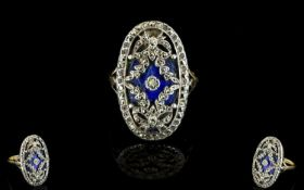 A Victorian Marcasite And Enamel Ring Oval ring with fleur de lys shoulder detail, the central