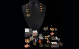 A Mixed Lot Comprising Masonic medals, red cross medal, reproduction coins, badges etc.