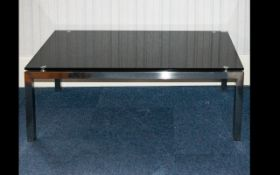 A Modern Glass Coffee Table Rectangular form in chromed metal and black glass, height 17 inches,