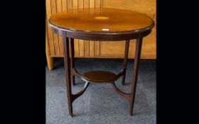 Edwardian Mahogany Occasional Table Of oval form with inlay detail to top,