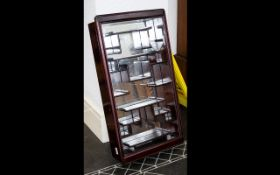 Modern Wall Mounted Display Cabinet. With mirrored back and rosewood effect finish.