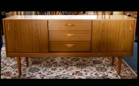 A 1970s Shreiber Sideboard, rectangular mid-century sideboard with three central drawers with