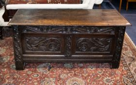 An 18th Century Carved Coffer Of large proportions,