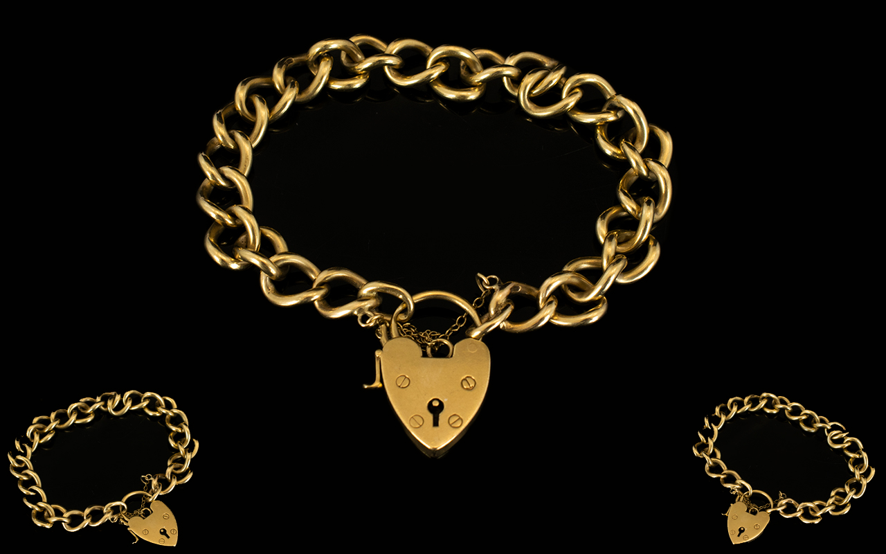 Lot 31 - 9ct Gold Heavy Curb Bracelet with Attached 9ct Gold Shield Shaped Padlock and Safety Chain.