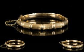 A 9ct Gold Hinged Bangle Bamboo effect design, fully hallmarked, 12 grams in weight,