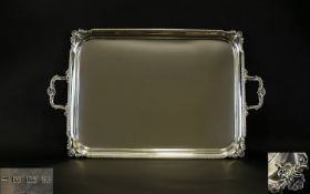 Victorian Period Good Quality and Heavy Twin Handle Silver Tray profusely decorated to borders and