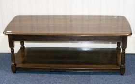 Ercol Dark Elm Coffee Table Of low rectangular form, very good condition,