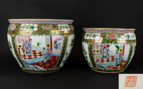 A Pair Of Oriental Fish Bowls / Jardinieres Each with gilt rim and traditional floral design.