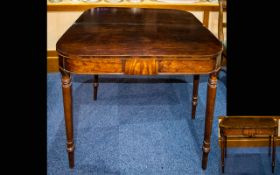 An Early 19th Century Mahogany Tea Table With fold over top, turned legs.