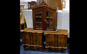 A Pair Of Shaped Three Drawer Mini Bedside Cabinets Dark wood,