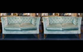 A Pair Of Two Seater Button Back Settee's High back sofas with button arms,