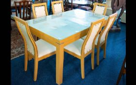 A Contemporary Kitchen Table And Chairs Finished in pale coloured composite with rectangular glass