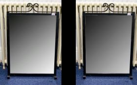 A Pair Of Contemporary Metal Framed Mirrors Two large rectangular mirrors in black metal frames