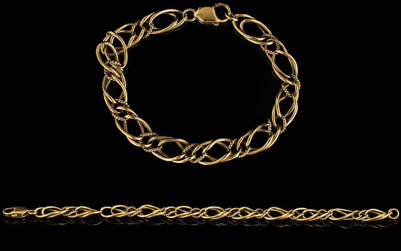 Lot 39 - 9ct Gold - Triple Link Fancy Bracelet with Good Quality Clasp. Fully Hallmarked for 9ct - 375 Gold.
