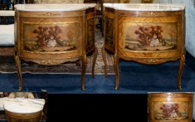 A Pair Of 20th Century French Style Marble Top Commodes Each of shaped form with ormolu mounts and