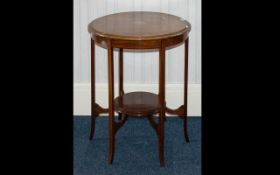 An Edwardian Occasional Table with inlaid ribbon banding to top and bottom stretcher,