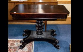 A 19th Century Rosewood Centre Table Rectangular top on carved acanthus and fluted column.