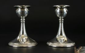 George V Pair of Silver Squat Candlesticks with Tapered Stems on a Circular Base.