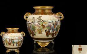 Japanese Meji Period Globular Twin Handle Vase Continuous scene depicting figures in mountainous