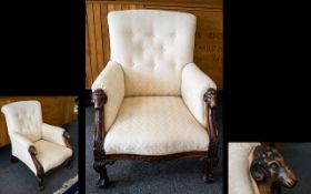 Ladies Button Back Low Armchair With carved rams head supports and claw feet.