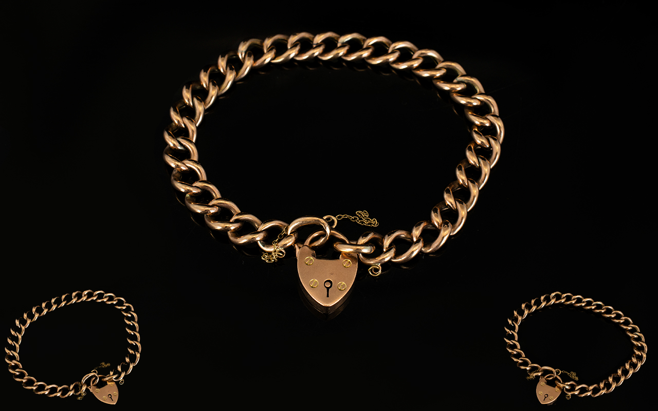 Lot 40 - 9ct Gold - Early Curb Bracelet with Attached 9ct Heart Shaped Padlock.