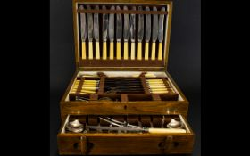 A Mid 20th Century Canteen Of Cutlery Hinged topped with single drawer and bone handles.