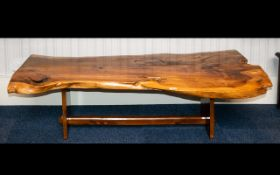 A Birchwood Freeform Plank Table, Length 60 inches, widest point 26 inches, height 16 inches.