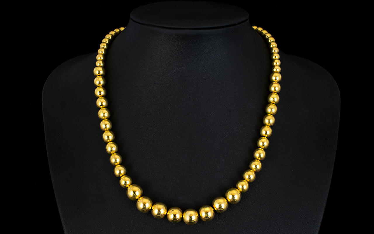 Lot 21 - Ladies Superb Quality 9ct Gold Graduated Bead Necklace In Solid Gold. Fully Hallmarked for 9.